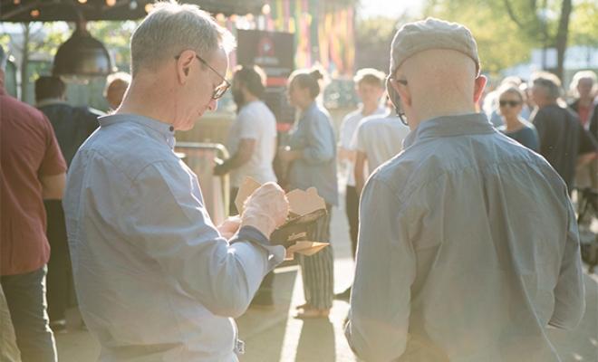 Two men enjoying a Pieminister