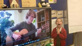 An excited pupil from St Matthews Primary School watches as their Musicat is revealed