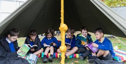 Children reading in tent at Literature Festival for Schools