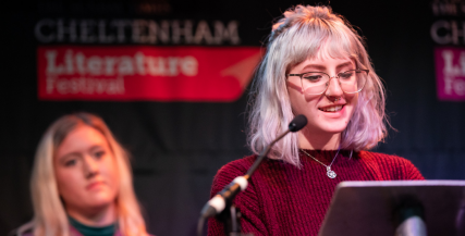 Young Writer reading on stage at Cheltenham Literature Festival