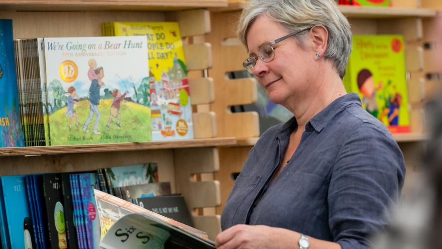 Lady browsing a book in the Cheltenham Literature Festival Bookshop